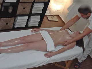 Young Brunette with Glasses Seduced on Massage Table